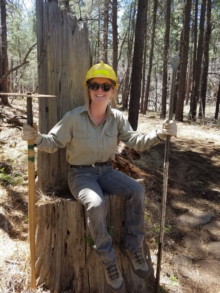 Forest Service Volunteer taking a break during construction