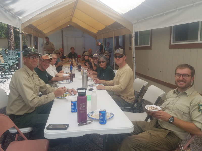 MUTS eating lunch after a clean-up.