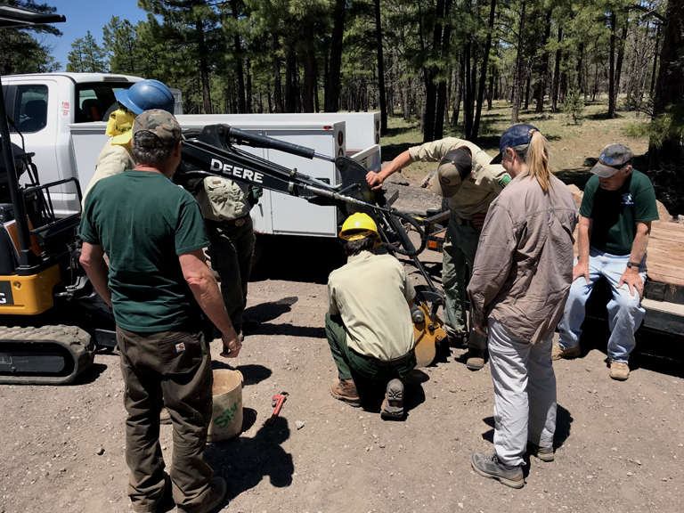 Crews use heavy equipment to install trail gate for the Munds Canyon Trailhead.